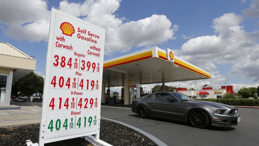A car leaves a Shell station after getting gas in Sacramento on May 17.