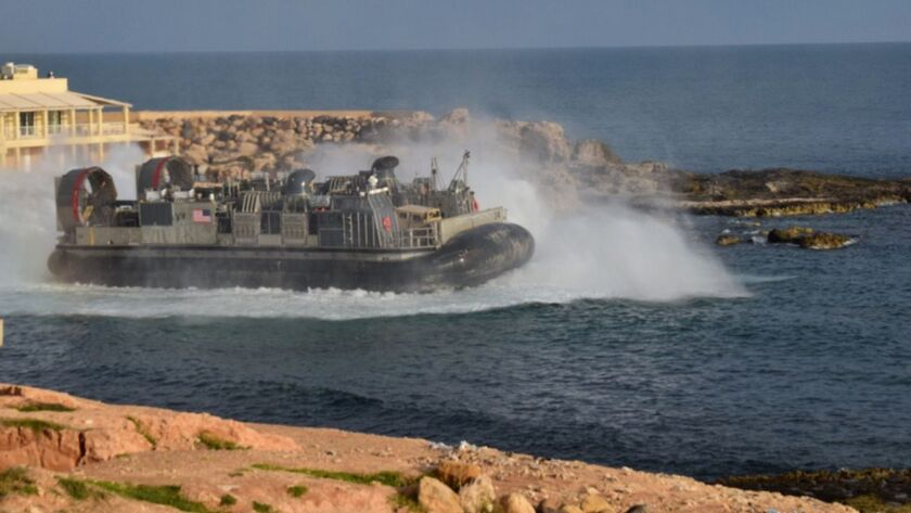 A U.S. amphibious hovercraft departs with evacuees from Janzur, west of Tripoli, Libya, Sunday, Apri
