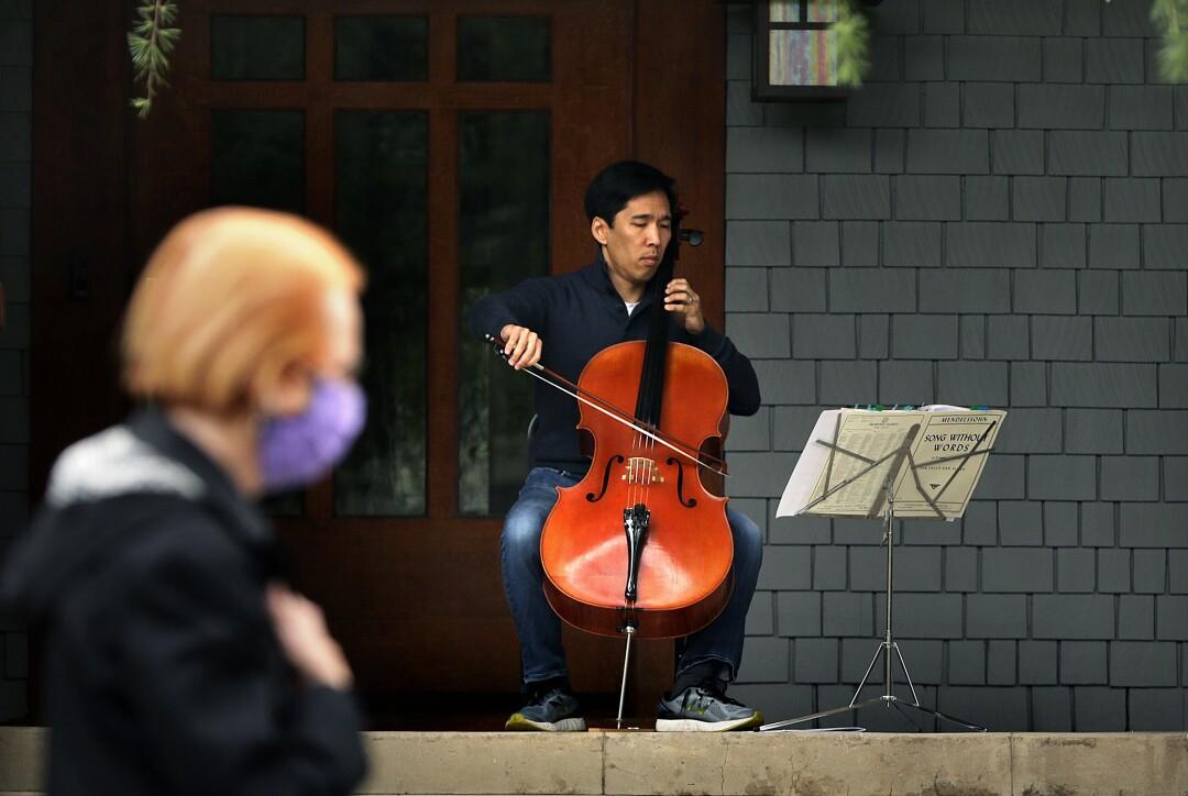 Cellist Beong-Soo Kim plays a socially distanced concert at their Pasadena home