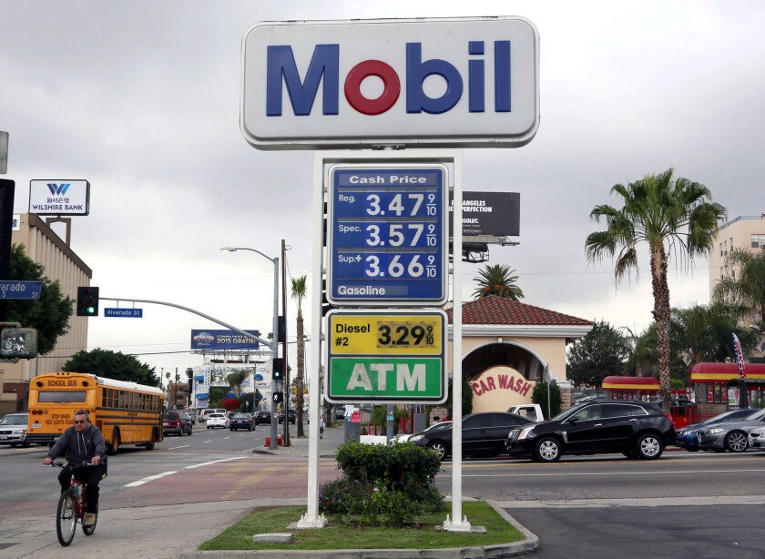 Sign at a gas station in Los Angeles in happier times, gas-price-wise.