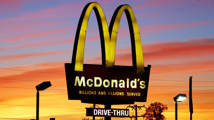 McDonald's will serve up books with its Happy Meals for the next two weeks.