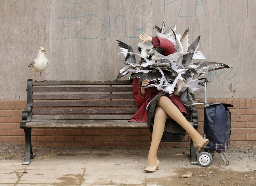 A Banksy piece depicting a woman attacked by seagulls is displayed at Banksy's biggest show to date, entitled 'Dismaland', during a press viewing in Western-super-Mare, Somerset, England, Thursday, Aug. 20, 2015. (Yui Mok/PA Wire via AP) UNITED KINGDOM OUT, NO SALES, NO ARCHIVE