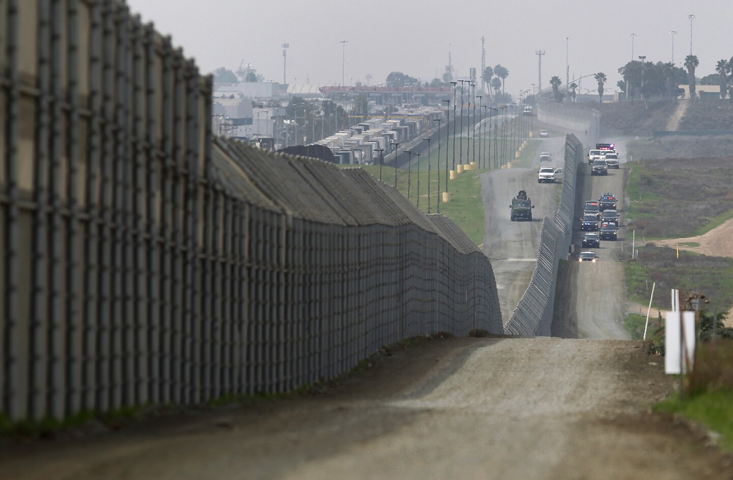 President Donald Trump's motorcade drives along the Mexico border on his way to tour the border wall prototypes near the Otay Mesa Port of Entry in San Diego County on March 13, 2018. (Photo by K.C. Alfred/ San Diego Union -Tribune)