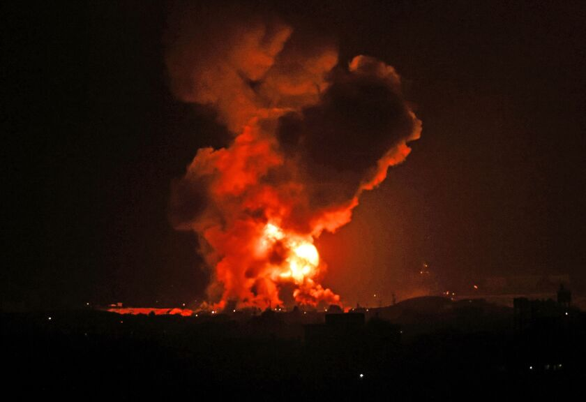 A fire rages following an Israeli air strike on the Gaza Strip on May 11.