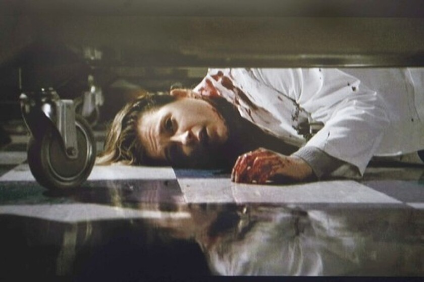 TURNING POINT: After the knife attack, Dr. Carter (Noah Wyle) fell to the floor and saw Lucy (Kellie Martin), also an attack victim.