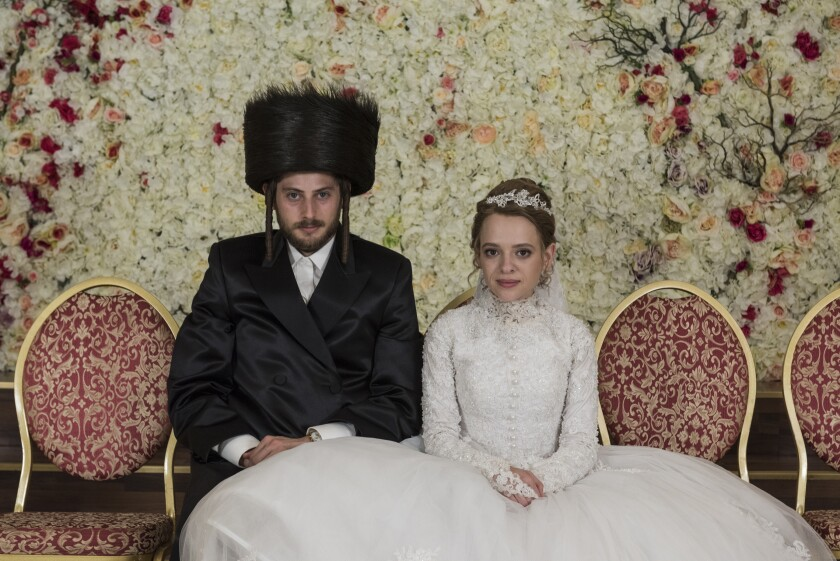 """Amit Rahav, left, and Shira Haas star in """"Unothodox,"""" a Netflix series about a young woman who flees her Hasidic community in Williamsburg, Brooklyn."""