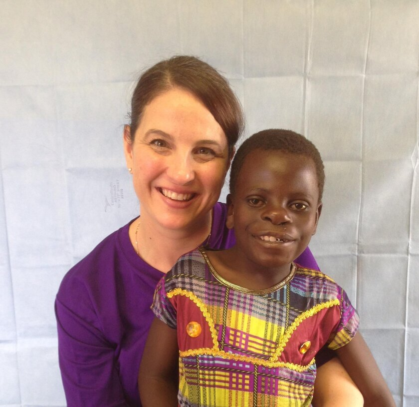 Amanda Gosman with a young patient following his surgery to repair a cleft palate.