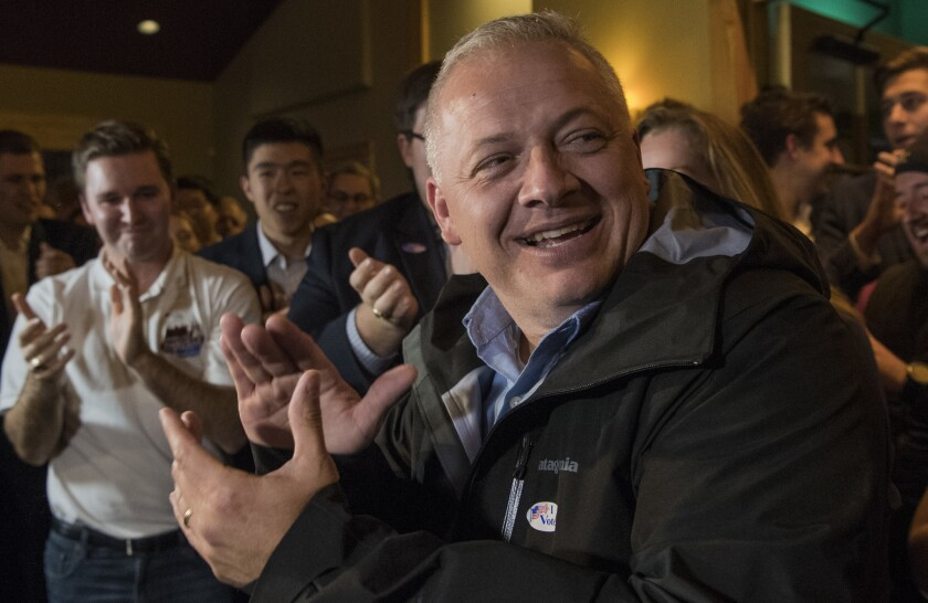 Denver Riggleman claps with the crowd during an election party in Afton, Va., on Tuesday.
