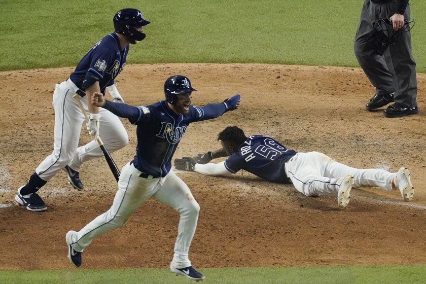 The Rays' Randy Arozarena scores the winning run in Game 4.