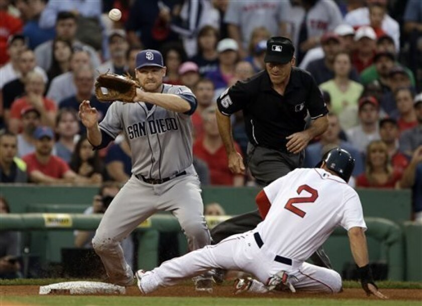 Boston Red Sox's Jacoby Ellsbury (2) slides into third safely tagging up on Shane Victorino's fly ball, as San Diego Padres third baseman Chase Headley tries to catch a throwduring the third inning of an interleague baseball game at Fenway Park in Boston, Tuesday, July 2, 2013. (AP Photo/Elise Amen