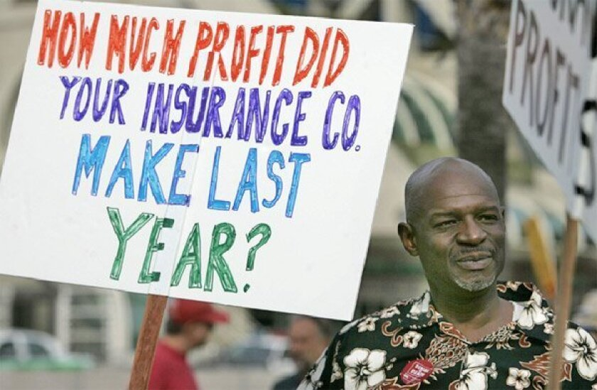 Maurice Walters of Ocean Beach was one of the protesters outside the  convention of America's Health Insurance Plans yesterday in San Diego. He  hasn't had insurance since 2006. (John Gibbins / Union-Tribune)