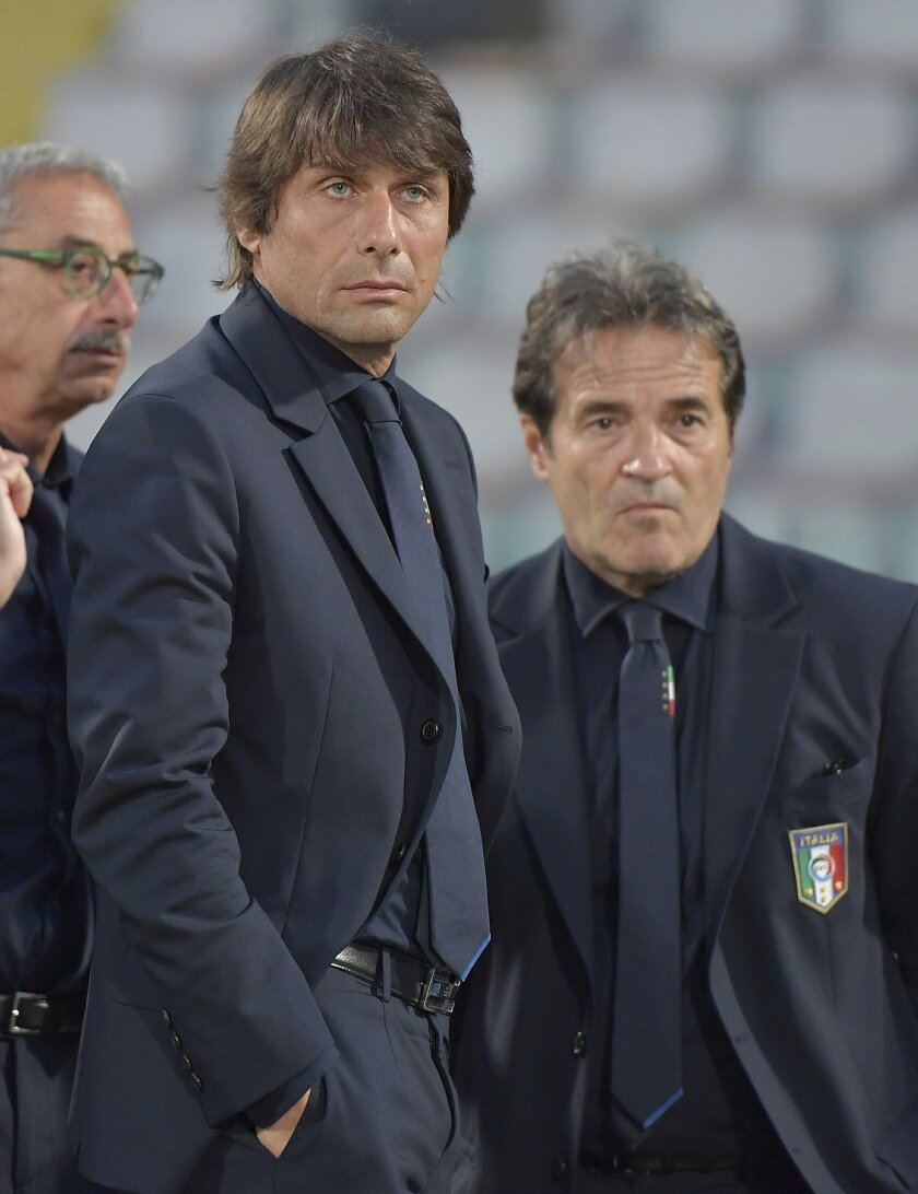 Italy's coach Antonio Conte looks on prior to the start of a friendly match between Italy and Scotland, in preparation for the upcoming Euro 2016 European Championships, at the Ta' Qali stadium in Attard, Malta, Sunday, May 29, 2016. (AP Photo/Rene Rossignaud)