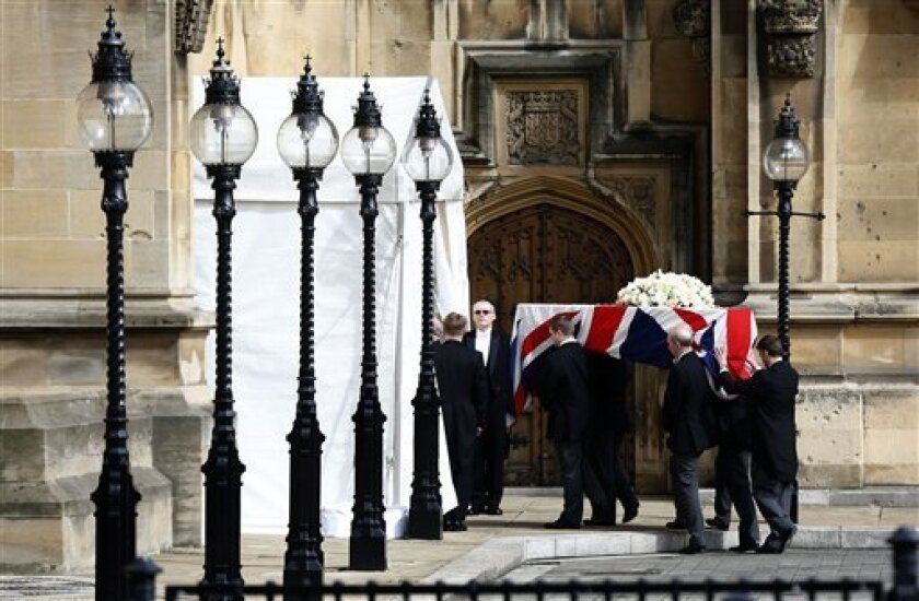 The Union Flag draped coffin holding the body of former British Prime Minister Margaret Thatcher is carried from a hearse as it arrives at the Houses of Parliament in London Tuesday April 16, 2013 to rest overnight before her funeral at St Paul's Cathedral on Wednesday . About 100 colleagues and senior politicians will attend a private service in Parliament's chapel of St. Mary Undercroft later Tuesday. (AP Photo/Sang Tan)