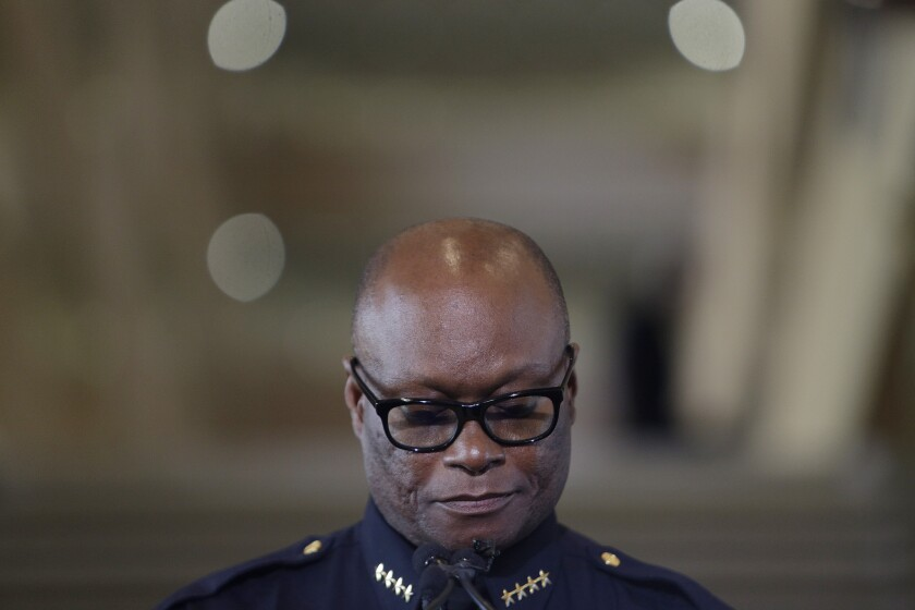 During a news conference Friday, Dallas Police Chief David Brown collects himself while talking about Thursday night's deadly shooting.