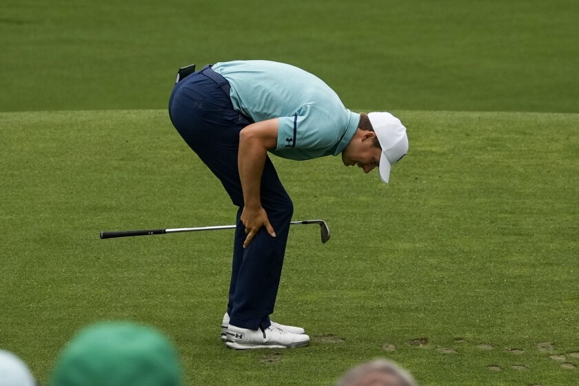 Jordan Spieth reacts after teeing off on the 12th hole during the second round of the Masters on Friday.