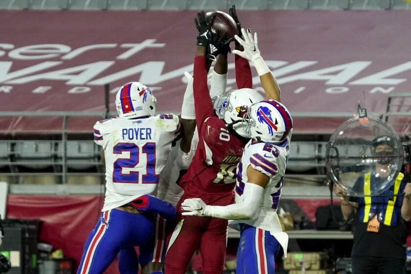 Cardinals wide receiver DeAndre Hopkins (10) beats three Bills players on a game-winning, Hail Mary touchdown catch.