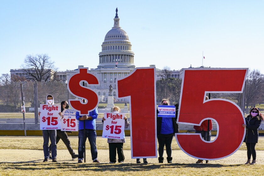 Activists appeal for a $15 minimum wage near the Capitol in Washington, Thursday, Feb. 25, 2021.