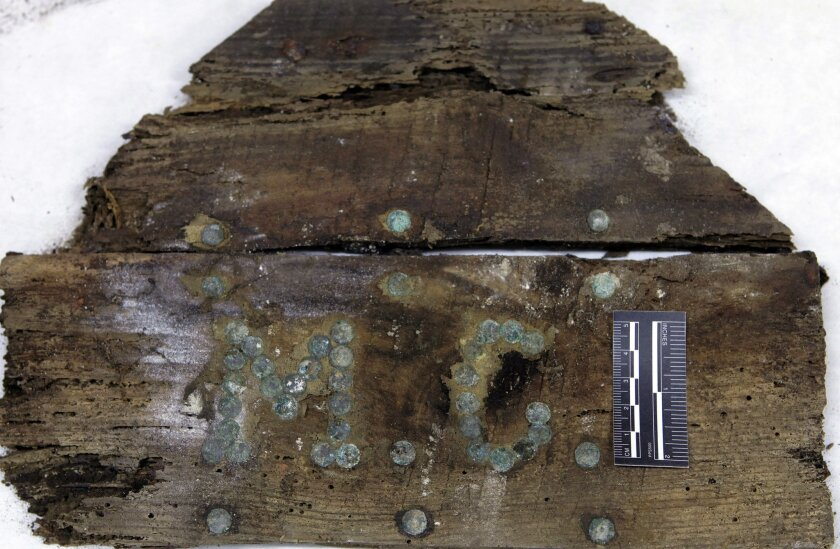 """The initials """"M.C"""" on a newly discovered coffin fragment found in a Spanish crypt. Could it hold the bones of Miguel de Cervantes?"""
