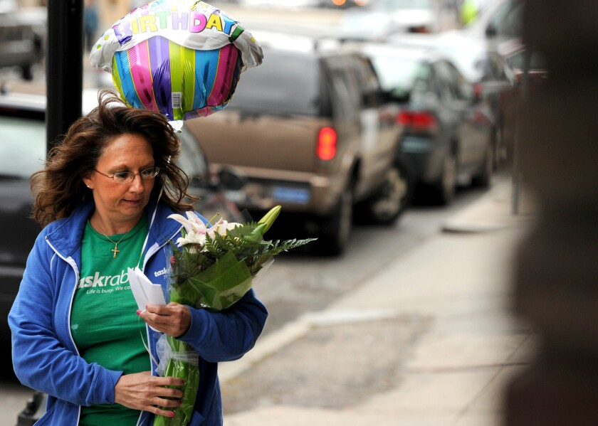 Diane Hohen, with TaskRabbit, delivers a bouquet of flowers in Boston in 2012.