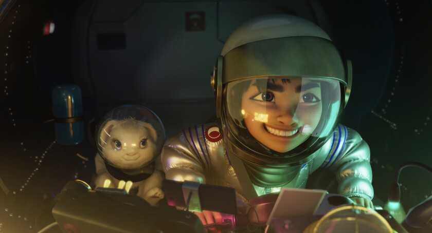 """This image released by Netflix shows characters Bungee the rabbit, left, and Fei Fei, voiced by Cathy Ang, in a scene from """"Over the Moon."""" (Netflix via AP)"""