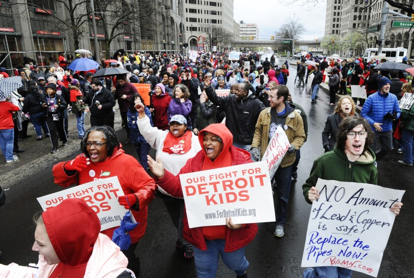 Members of the Detroit Federation of Teachers rally in front of the Detroit Public Schools offices on May 2, 2016.