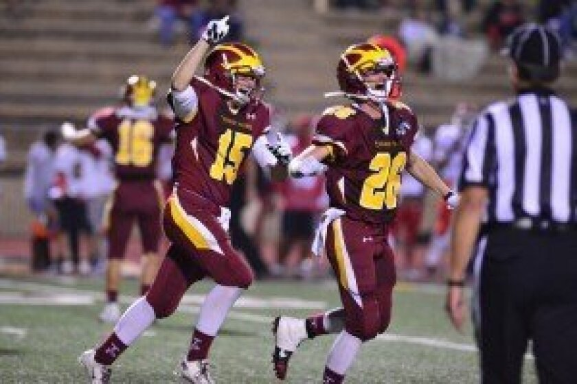 Torrey Pines players Harrison Cohen and Matthew Feeler celebrate a touchdown in the Falcons' 44-9 triumph over Vista High on Sept. 20. Photo/Anna Scipione
