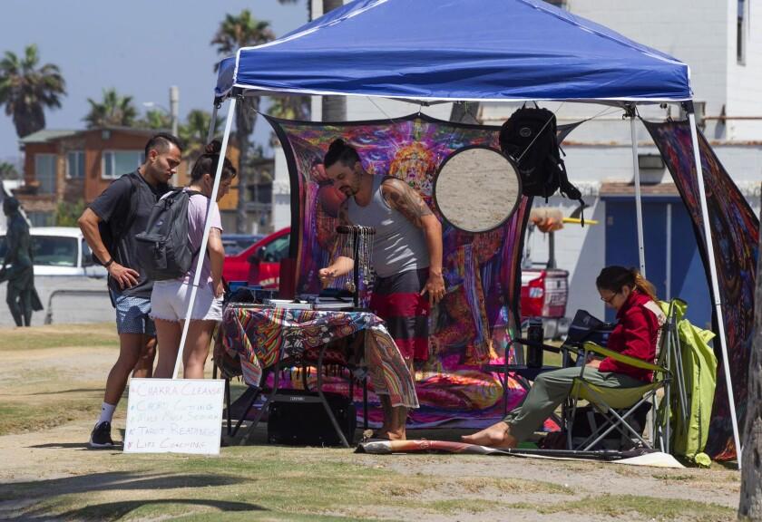 Streetside vendors sell their wares in Ocean Beach in 2019.