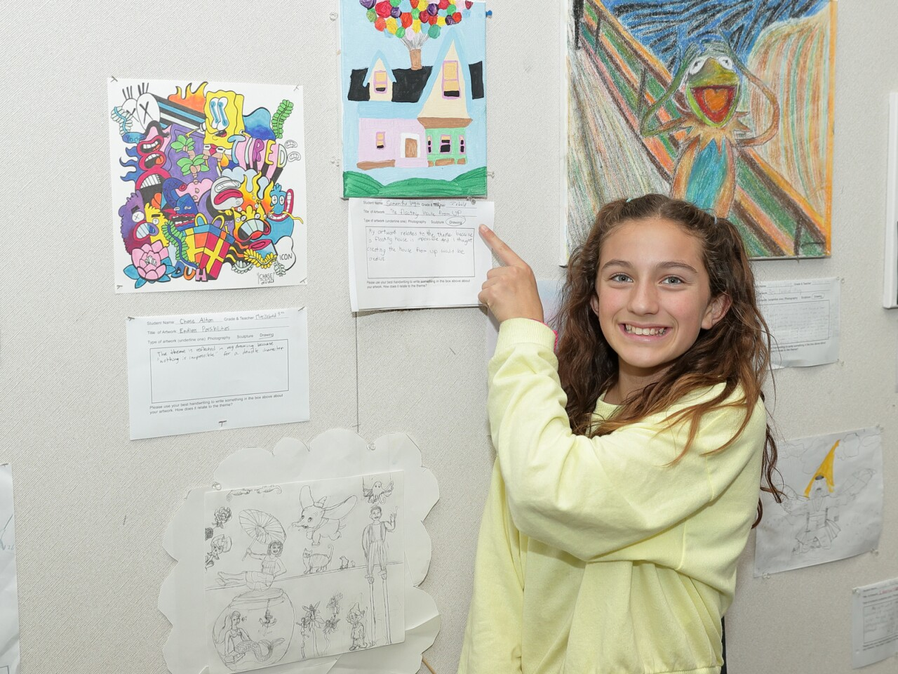 5th grader Samantha Vargas with her artwork titled The Floating House from UP