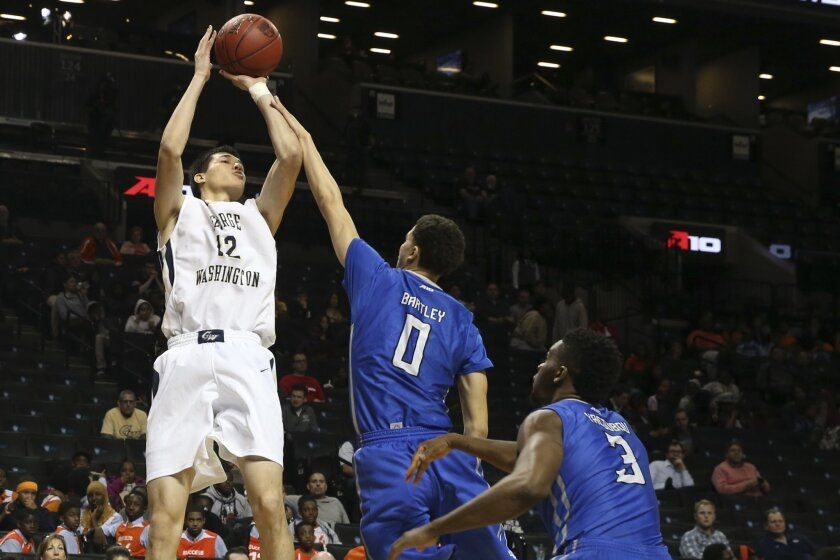 George Washington forward Yuta Watanabe (12) shoots past Saint Louis guard Marcus Bartley (0) and guard Ash Yacoubou (3) during the first half of an NCAA college basketball game in the Atlantic 10 men's tournament, Thursday, March 10, 2016, in New York. (AP Photo/Mary Altaffer)