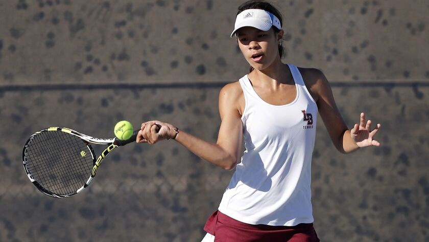 Laguna Beach High No. 1 doubles player Megan Mindt plays against Marina during a Wave League match a