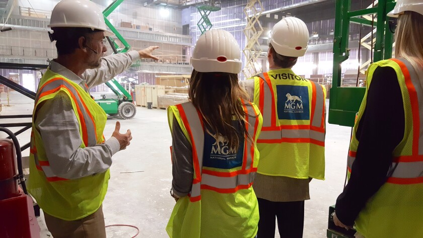 Sarah Jessica Parker and business partner George Malkemus III tour the hotel site during construction.
