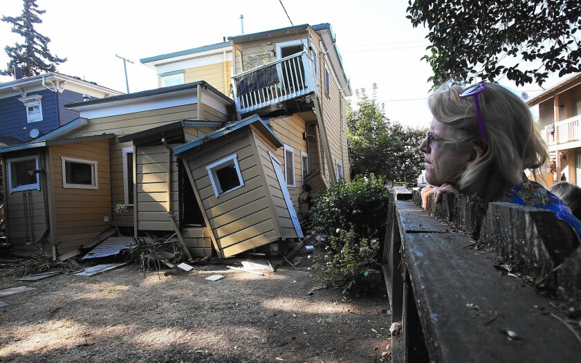 Vickie Katsubayashi looks at a red-tagged home near downtown Napa after the 6.0-magnitude earthquake in August.