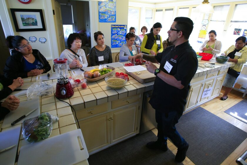 Miguel Valdez, executive chef of The Red Door restaurant led the bilingual cooking lesson for Cooking for Salud at the Olivewood Gardens and Learning Center in National City.