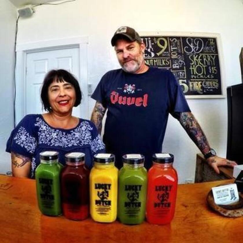 Lucky Dutch Juice Company owners Jonny Dunhowe and Starlene Roop, (Ken Lewis