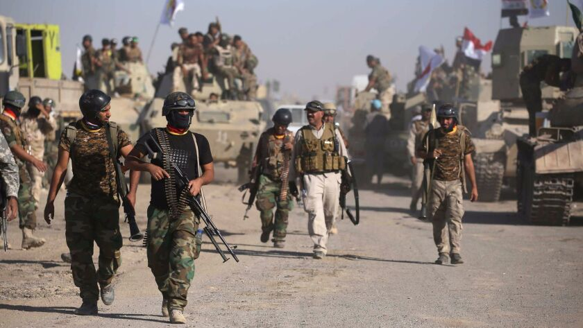 Iraqi government forces supported by fighters from the Abbas Brigade, which fights under the umbrell