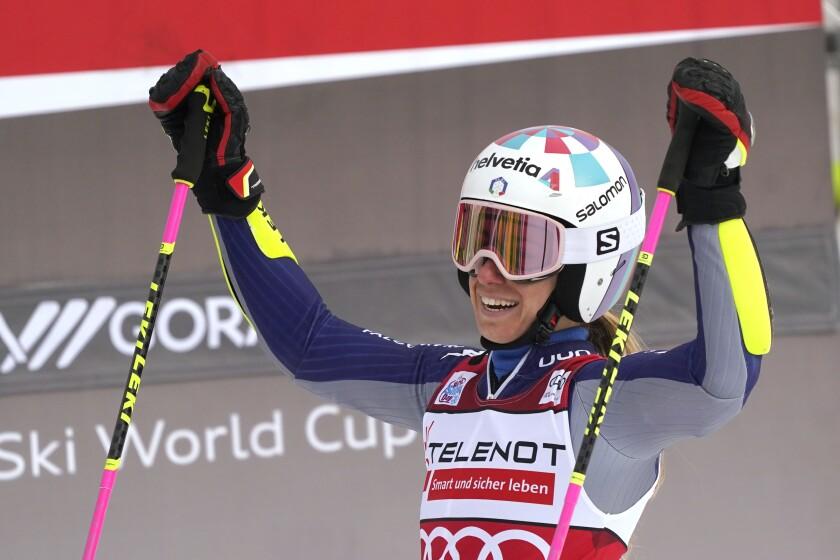 Italy's Marta Bassino celebrates after completing an alpine ski, women's World Cup giant slalom, in Kranjska Gora, Slovenia, Sunday, Jan. 17, 2021. (AP Photo/Giovanni Auletta)