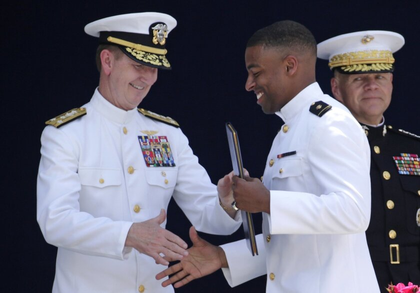 U.S. Naval Academy superintendent Ted Carter, Jr., left, presents a diploma to Keenan Reynolds, graduating Midshipman and the Baltimore Ravens' sixth round NFL draft pick, during the Academy's graduation and commissioning ceremony in Annapolis, Md., Friday, May 27, 2016. U.S. Defense Secretary Ash