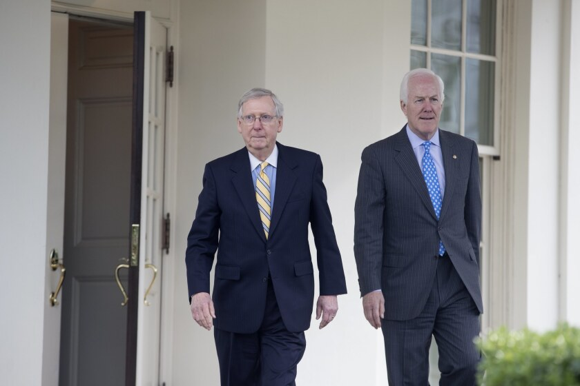 Senate Majority Leader Mitch McConnell (R-Ky.), left, and Sen. John Cornyn (R-Texas), the majority whip, leave the West Wing of the White House on Tuesday.