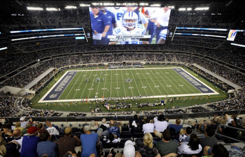 Video screens, like this one at Cowboys Stadium, will become a bigger part of the fan experience next season in the NFL.