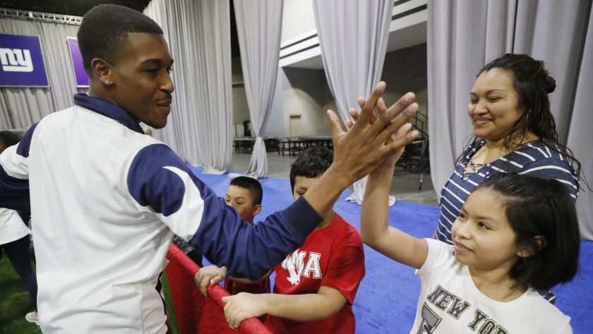 ATLANTA GEORGIA JANUARY 28, 2019-Actor Dallas Dupree Young dances with the Rams cheerleaders during
