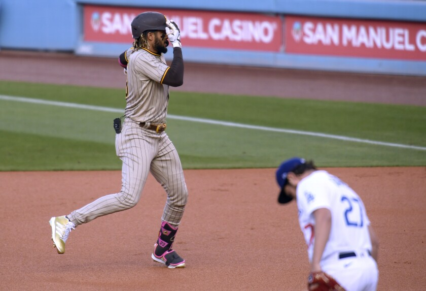 Fernando Tatis Jr. celebrates his solo home run in front of Dodgers pitcher Trevor Bauer.