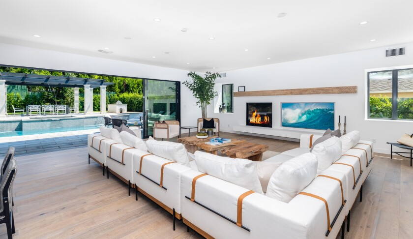 The four-bedroom home boasts an indoor-outdoor floor plan with white walls and white oak floors.