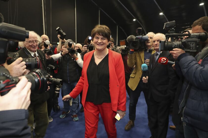Leader of the Democratic Unionist Party Arlene Foster arrives as the counting continues at the Titanic exhibition centre, Belfast, Northern Ireland for the 2019 general election, Friday Dec. 13, 2019. The first handful of results to be declared in Britain's election are showing a surge in support for to the Conservatives in northern England seats where Labour has long been dominant. (Liam McBurney/PA via AP)