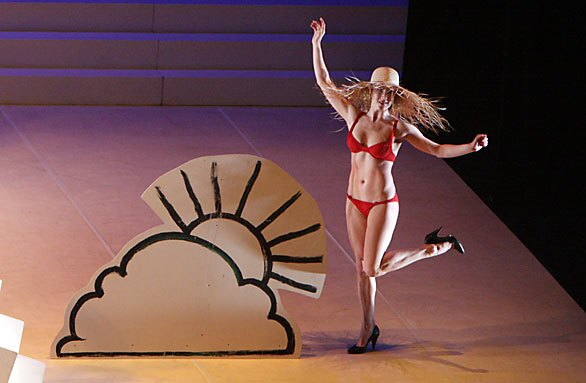 "Caroline Finn, a member of Ballet Preljocaj, performs as ""Miss Meteo"" during ""Les 4 Saisons ..., "" a fantastical interpretation of Vivaldi's ""The Four Seasons"" at UCLA's Royce Hall."