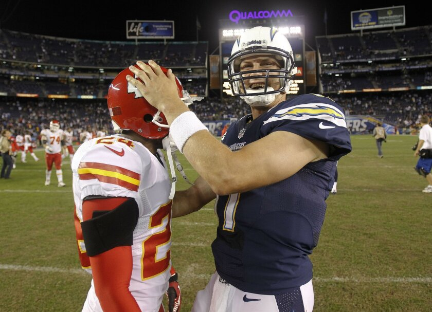 Philip Rivers with Chiefs Brandon Flowers after the game.