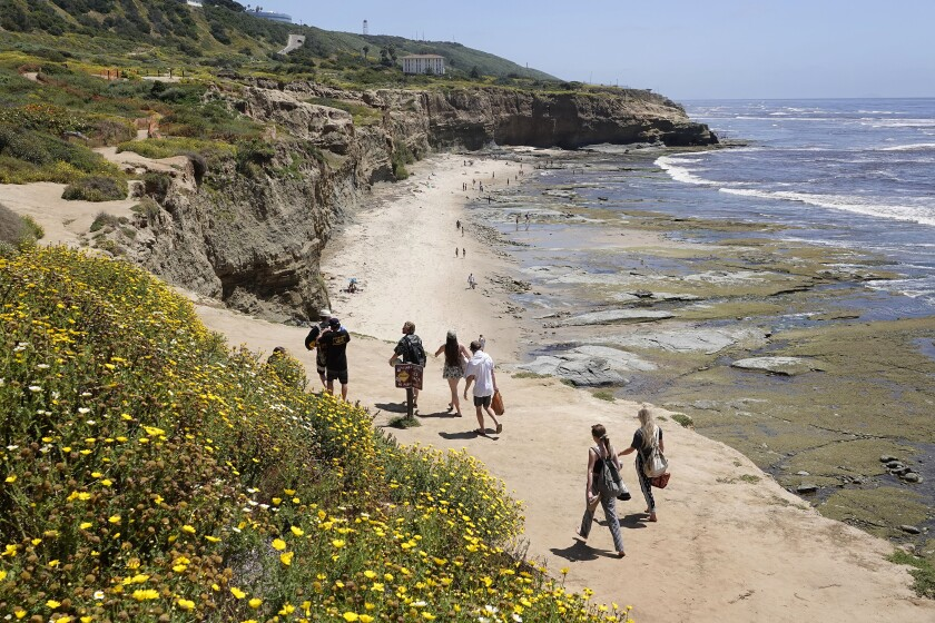People visit Sunset Cliffs on May 3. Large crowds have been reported there day and night recently.