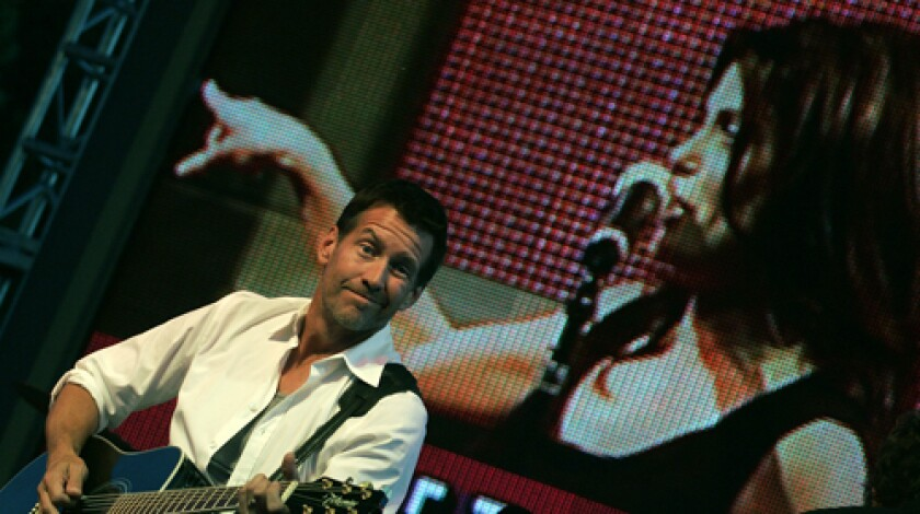 """ONSTAGE: James Denton accompanies """"Desperate Housewives"""" costar Teri Hatcher during the show Saturday."""