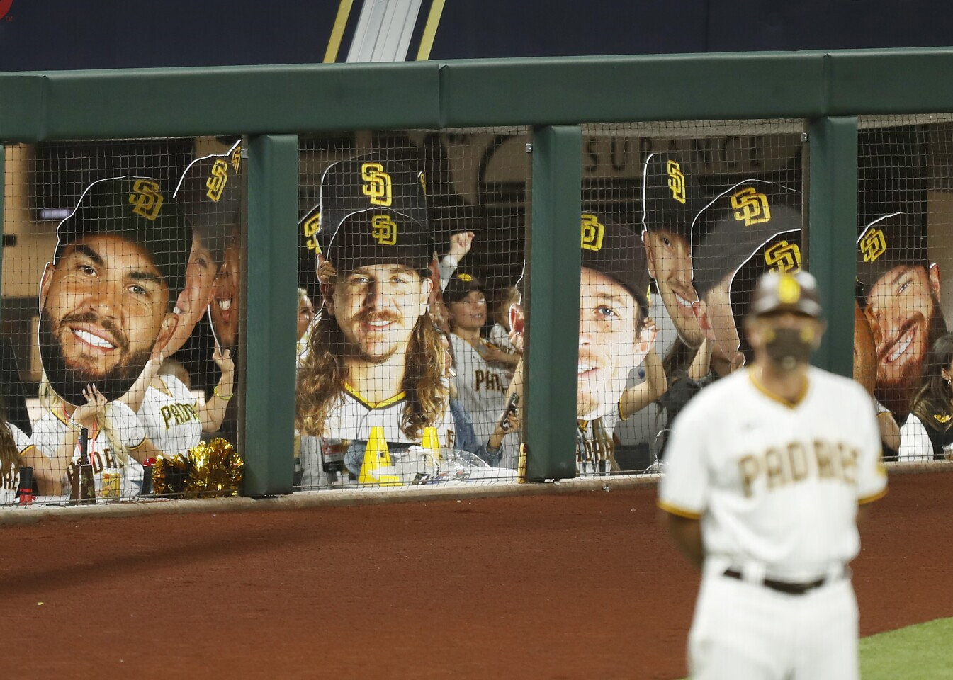 Wives, girlfriends, and family of the San Diego Padres hold up