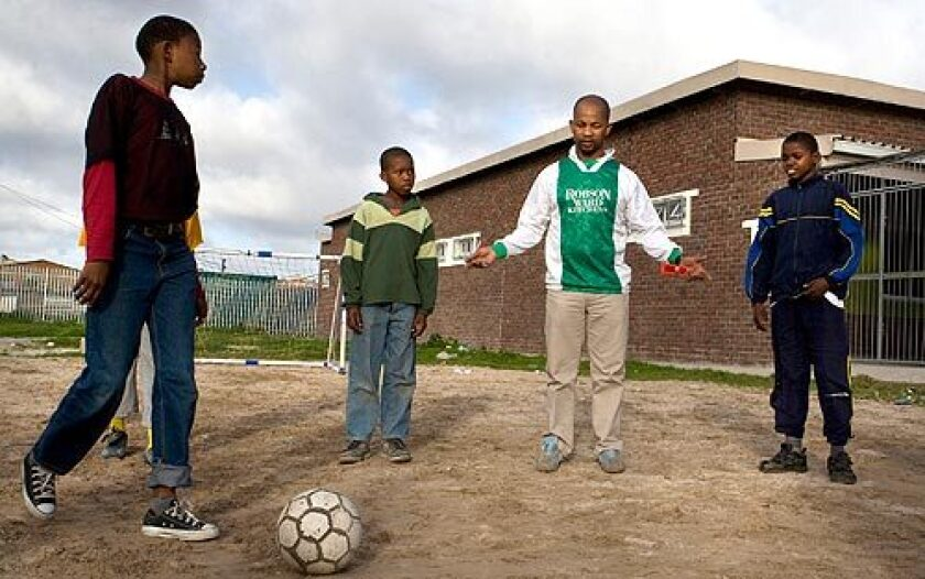 Easy Nofemela, a onetime soccer star, coaches a soccer team as part of his work with the Amy Biehl Foundation in Cape Town, South Africa. In 1993, Nofemela was part of the mob that attacked Biehl, and he was among four men convicted of her murder. After his release from prison, Nofemela became a community leader and went on to work for the charity that bears Biehl's name.