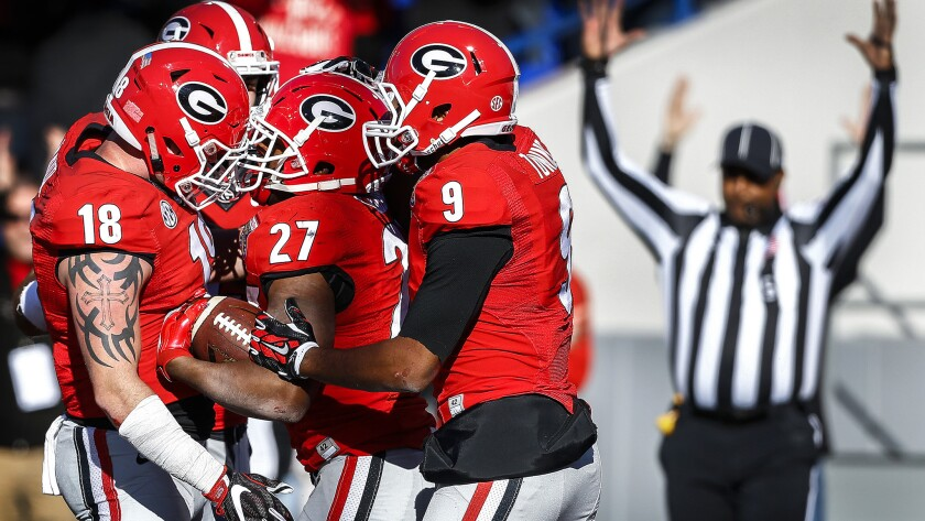 Georgia running back Nick Chubb (27) celebrates with teammates after scoring a touchdown against TCU during the fourth quarter Friday.